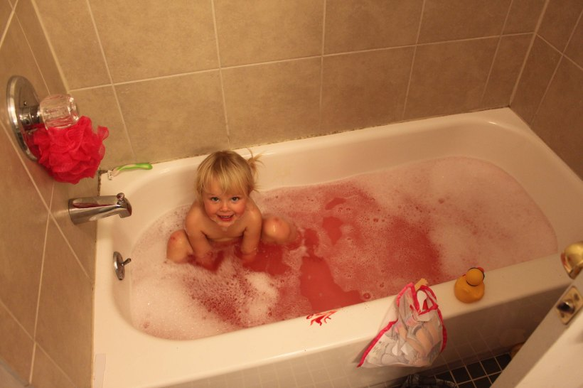 poured a whole bottle of red paint in her tub