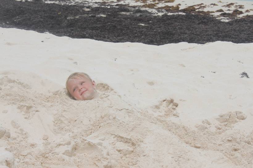 Daddy buried Lily in the sand