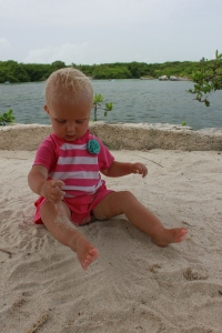 Birthday Girl playing with sand next to the lagoon at Xel-ha
