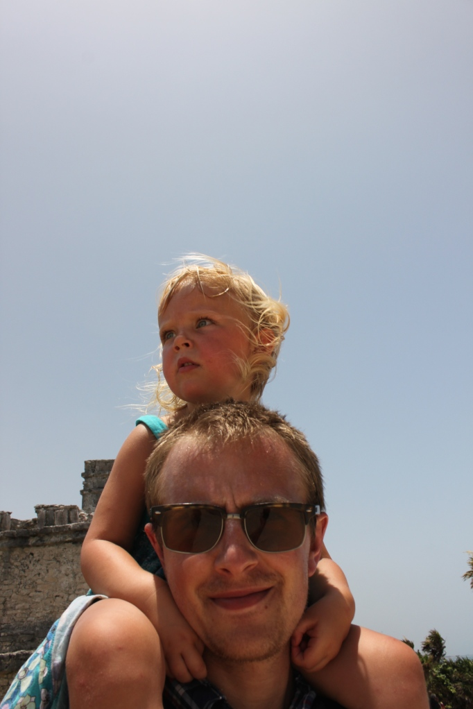 Riding on Daddy's shoulders